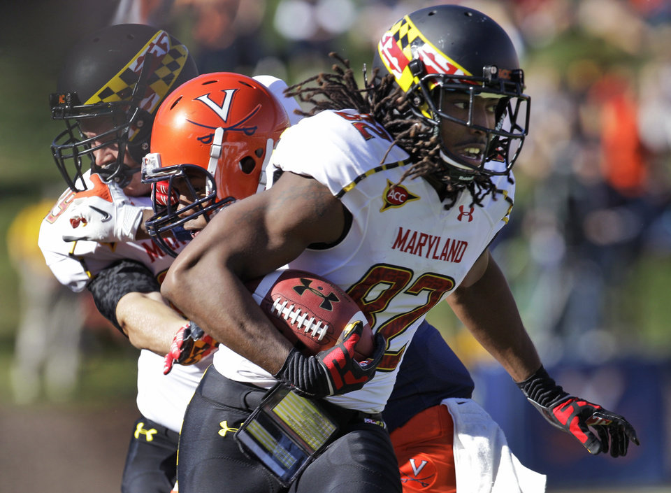 Photo -   Maryland wide receiver Marcus Leak (82) gains yardage after a catch during an NCAA college football game against Virginia in Charlottesville, Va., Saturday, Oct. 13, 2012. (AP Photo/Steve Helber)