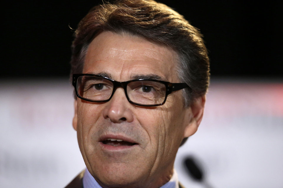 Photo - FILE - In this Friday, Aug. 8, 2014, file photo, Texas Gov. Rick Perry delivers a speech to nearly 300 in attendance at the 2014 RedState Gathering, in Fort Worth, Texas. Perry was indicted on Friday, Aug. 15, 2014, for abuse of power after carrying out a threat to veto funding for state public corruption prosecutors. (AP Photo/Tony Gutierrez, File)