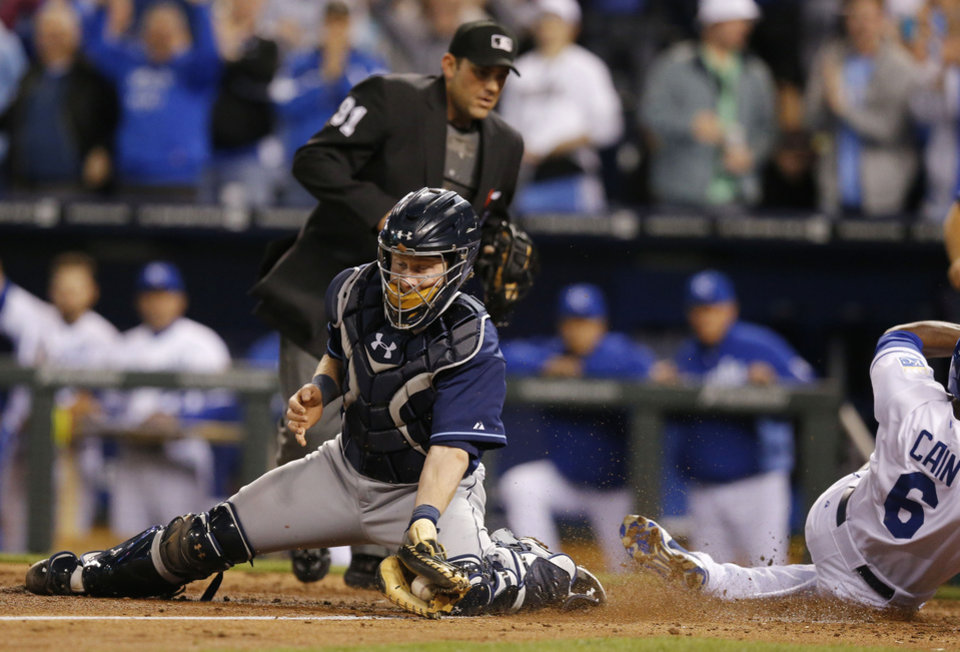 Photo - Tampa Bay Rays catcher Ryan Hanigan catches the ball after Kansas City Royals' Lorenzo Cain (6) scored during the sixth inning of the MLB American League baseball game at Kauffman Stadium in Kansas City, Mo., Monday, April 7, 2014. (AP Photo/Orlin Wagner)