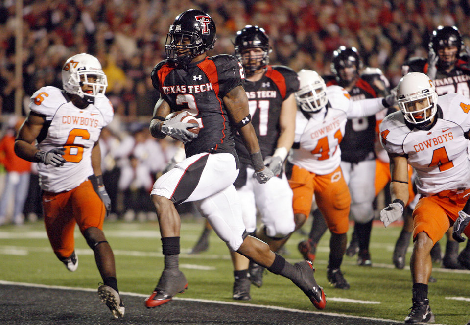 Texas Tech's Shannon Woods (2) cuts through the Oklahoma State defense for a touchdown during the first half of the college football game between the Oklahoma State University Cowboys (OSU) and the Texas Tech Red Raiders at Jones AT&T Stadium on Saturday, Nov. 8, 2008, in Lubbock, Tex.