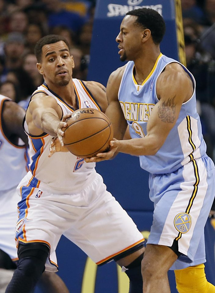 Oklahoma City's Thabo Sefolosha (2) defends on Denver's Andre Iguodala (9) during the NBA basketball game between the Oklahoma City Thunder and the Denver Nuggets at the Chesapeake Energy Arena on Wednesday, Jan. 16, 2013, in Oklahoma City, Okla.  Photo by Chris Landsberger, The Oklahoman