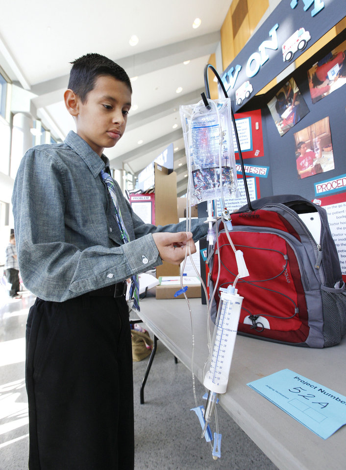 "Fourth-grader Casey Looper, 10, from Heritage Trails Elementary in Moore, shows off his ""IV on the Go"" invention."