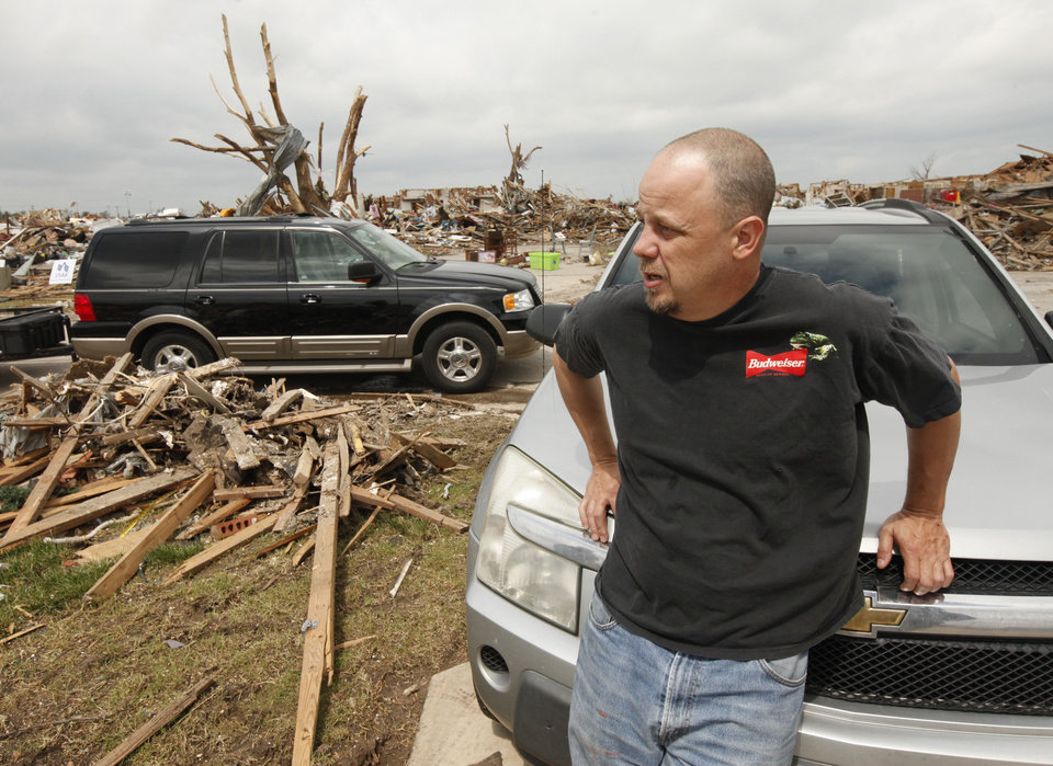Photo - Resident Randy Wheeler talks about the cleanup of the rubble of his home which was destroyed by the May 20th tornado near 145th and Robinson in Moore, OK, Saturday, May 25, 2013,  Photo by Paul Hellstern, The Oklahoman