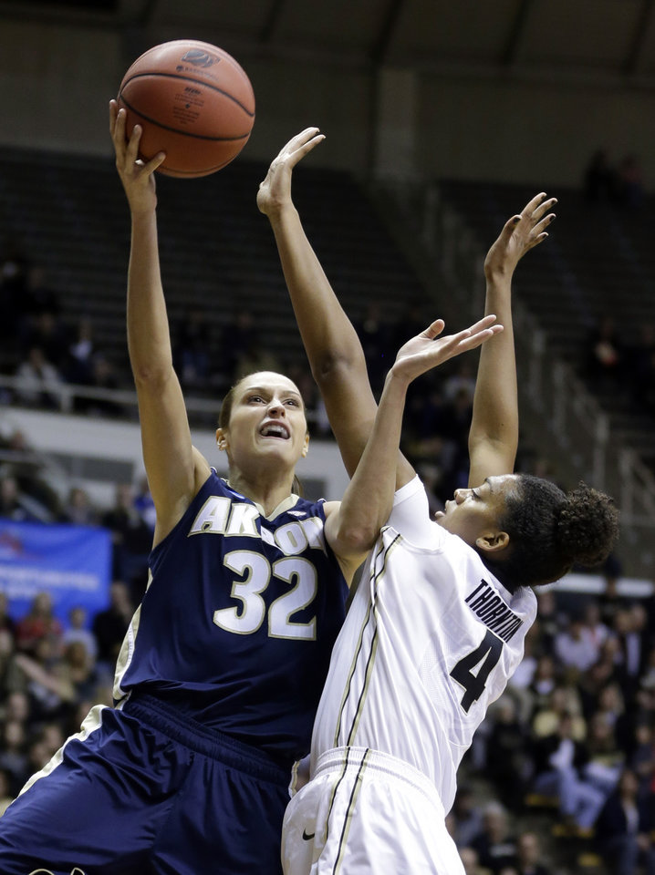 Photo - Akron forward Rachel Tecca (32) shoots over Purdue forward Torrie Thornton during the first half of a first-round game in the NCAA women's college basketball tournament, Saturday, March 22, 2014, in West Lafayette, Ind. (AP Photo/Michael Conroy)