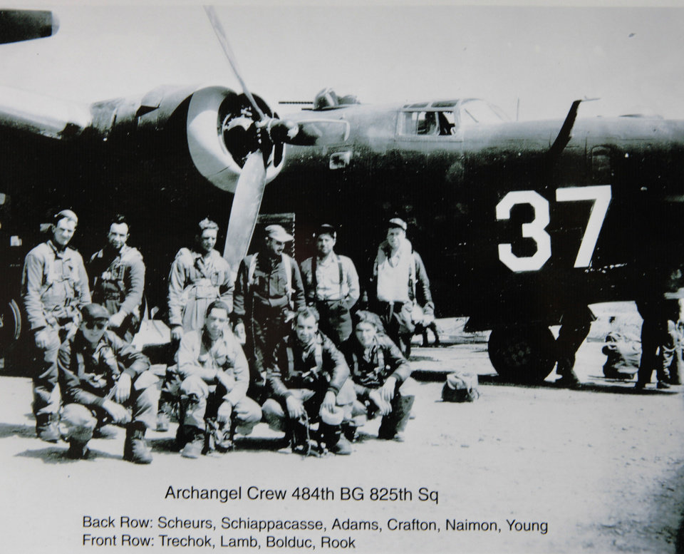 Copy photo of Ed Lamb's B-24 crew during WW II, Saturday, February 23, 2013. Lamb was twice ordered to parachute from damaged aircraft during WWII and now years latter he has jumped. Photo By David McDaniel/The Oklahoman <strong>David McDaniel - The Oklahoman</strong>