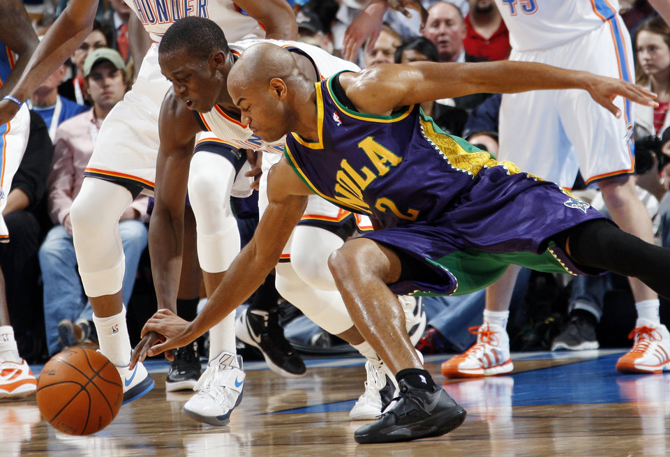 Oklahoma City's Reggie Jackson (15) and New Orleans' Jarrett Jack (2) chase a loose ball during an NBA basketball game between the Oklahoma City Thunder and the New Orleans Hornets at the Chesapeake Energy Arena in Oklahoma City, Monday, Feb. 20, 2012. Photo by Nate Billings, The Oklahoman