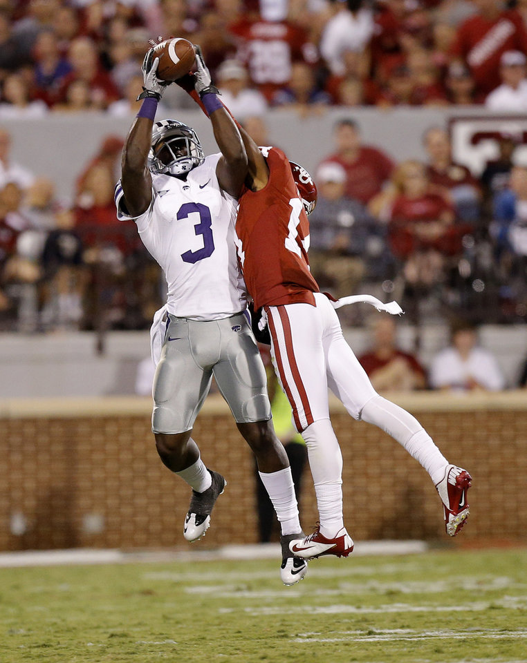 Photo - Kansas State's Chris Harper (3) catches the ball beside Oklahoma's Aaron Colvin (14) during a college football game between the University of Oklahoma Sooners (OU) and the Kansas State University Wildcats (KSU) at Gaylord Family-Oklahoma Memorial Stadium, Saturday, September 22, 2012. Oklahoma lost 24-19. Photo by Bryan Terry, The Oklahoman