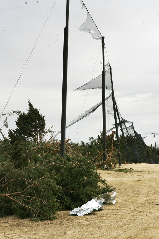 Photo - This driving range barrier net was ripped to pieces by the tornado at Oak Tree Golf and Country Club in Edmond, OK, Thursday, Feb. 12, 2009. BY PAUL HELLSTERN, THE OKLAHOMAN