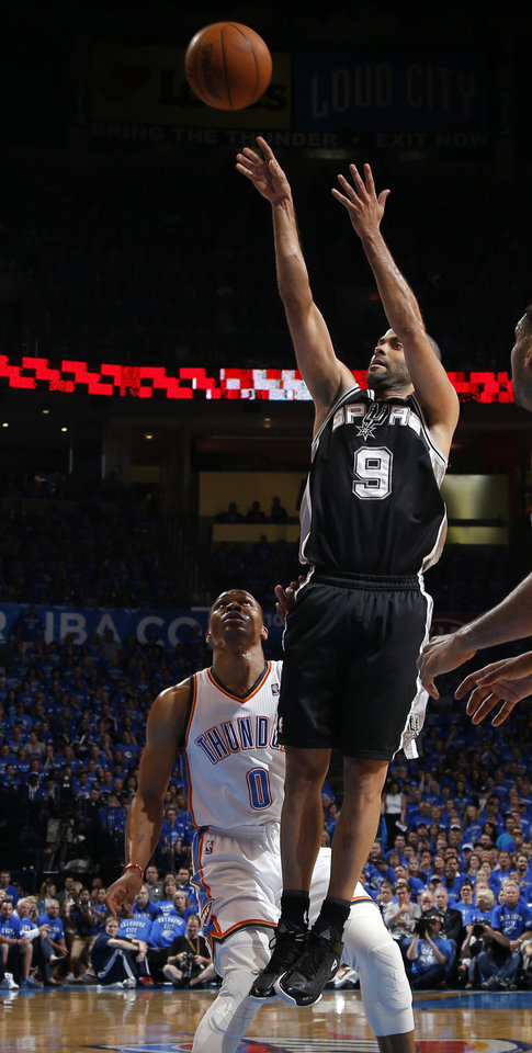 Photo - San Antonio's Tony Parker (9) shoots in front of Oklahoma City's Russell Westbrook (0) during Game 3 of the Western Conference Finals in the NBA playoffs between the Oklahoma City Thunder and the San Antonio Spurs at Chesapeake Energy Arena in Oklahoma City, Sunday, May 25, 2014. Photo by Bryan Terry, The Oklahoman
