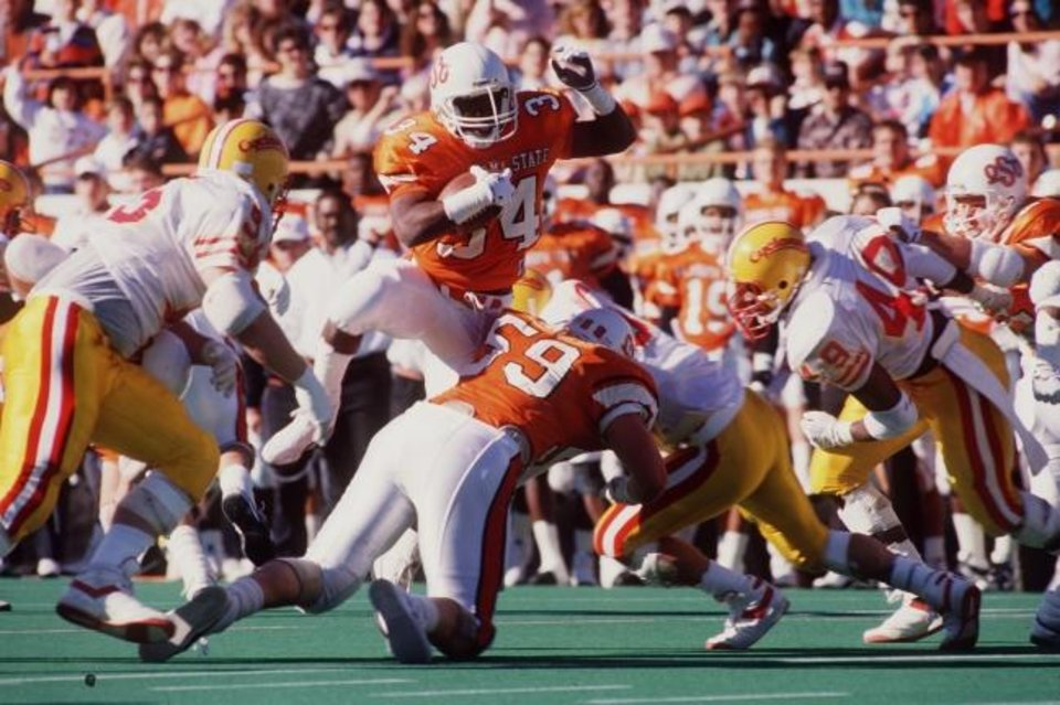 Photo -  Thurman Thomas still holds OSU's career rushing record with 5,001 yards from 1984-87. [OKLAHOMAN ARCHIVES]