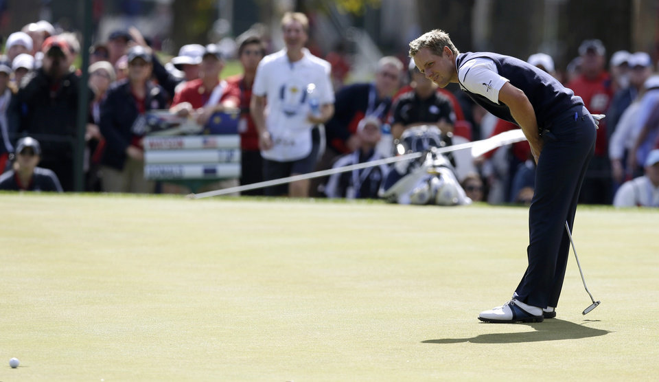Photo - Europe's Luke Donald reacts after missing a birdie putt on the third hole during a singles match at the Ryder Cup PGA golf tournament Sunday, Sept. 30, 2012, at the Medinah Country Club in Medinah, Ill. (AP Photo/David J. Phillip)  ORG XMIT: PGA114