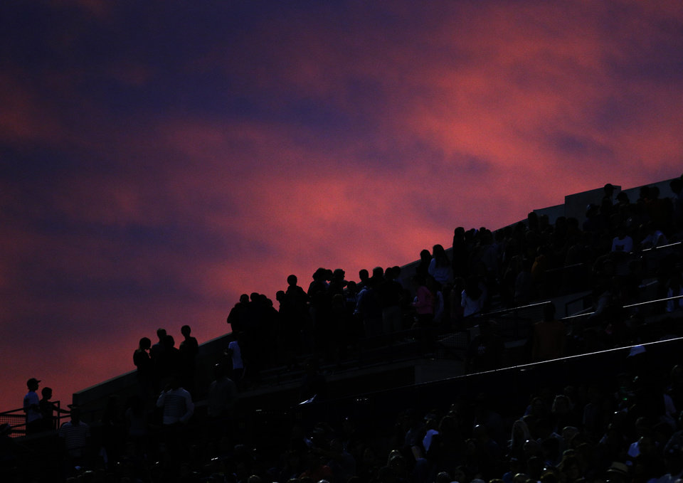 The sun sets as fans watch the high school football game between Edmond North High School and Edmond Santa Fe High School at Wantland Stadium in Edmond, Okla.,  Friday, Sept. 20, 2013. Photo by Sarah Phipps, The Oklahoman