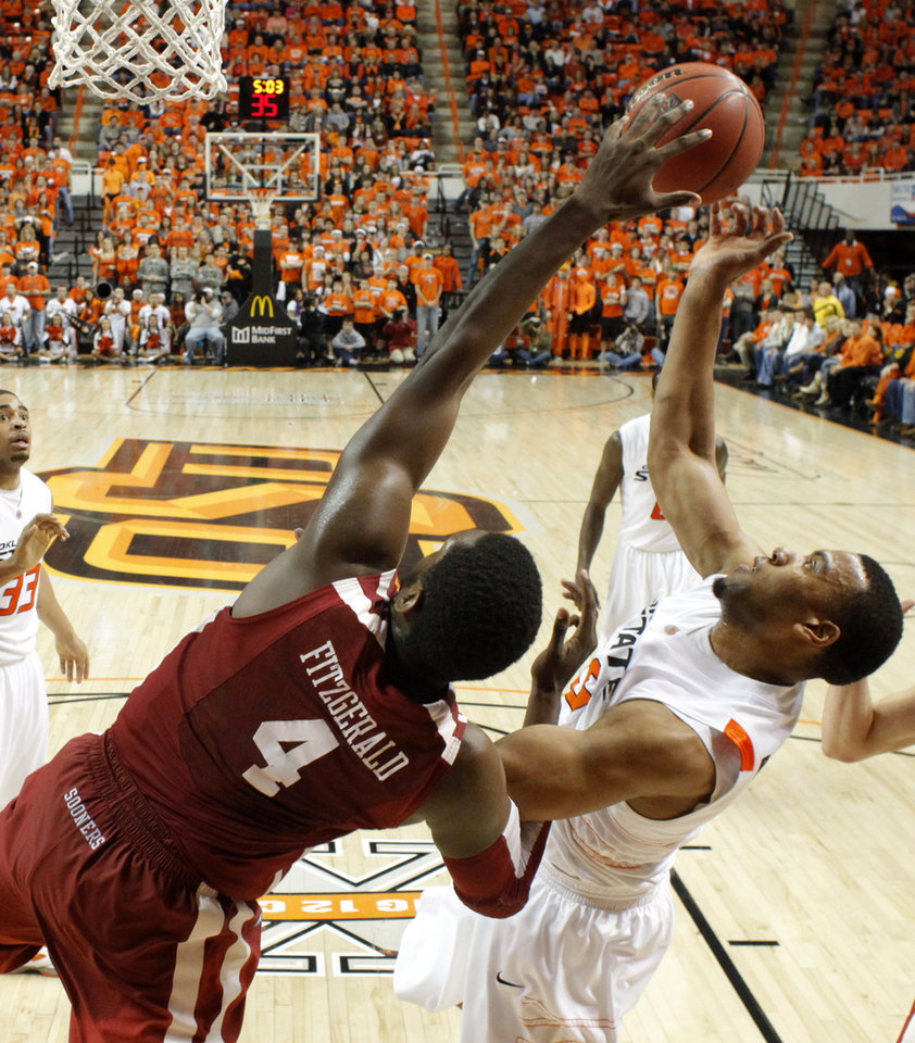 Photo - Oklahoma State's Darrell Williams (25) goes to the basket beside Oklahoma's Andrew Fitzgerald (4) during the Bedlam men's college basketball game between the University of Oklahoma Sooners and Oklahoma State University Cowboys at Gallagher-Iba Arena in Stillwater, Okla., Saturday, February, 5, 2011. Photo by Bryan Terry, The Oklahoman