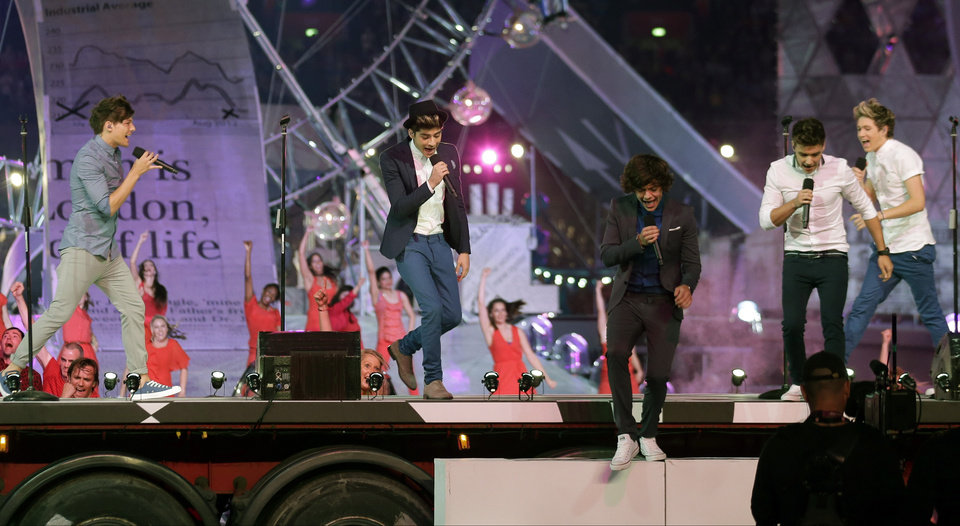 Photo -   One Direction perform during the Closing Ceremony at the 2012 Summer Olympics, Sunday, Aug. 12, 2012, in London. (AP Photo/Charlie Riedel)
