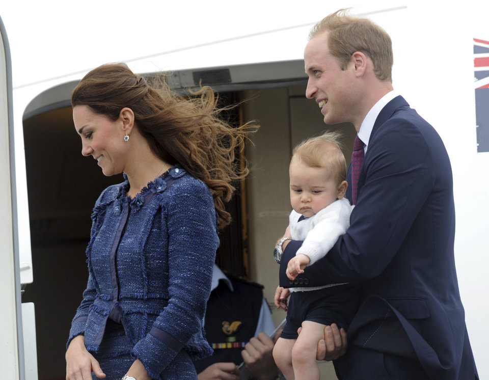 Britain\'s Prince William carries Prince George with his wife Kate, the Duchess of Cambridge as they depart for Sydney, Australia, from Wellington, New Zealand, Wednesday, April 16, 2014. (AP Photo/SNPA, Ross Setford) NEW ZEALAND OUT