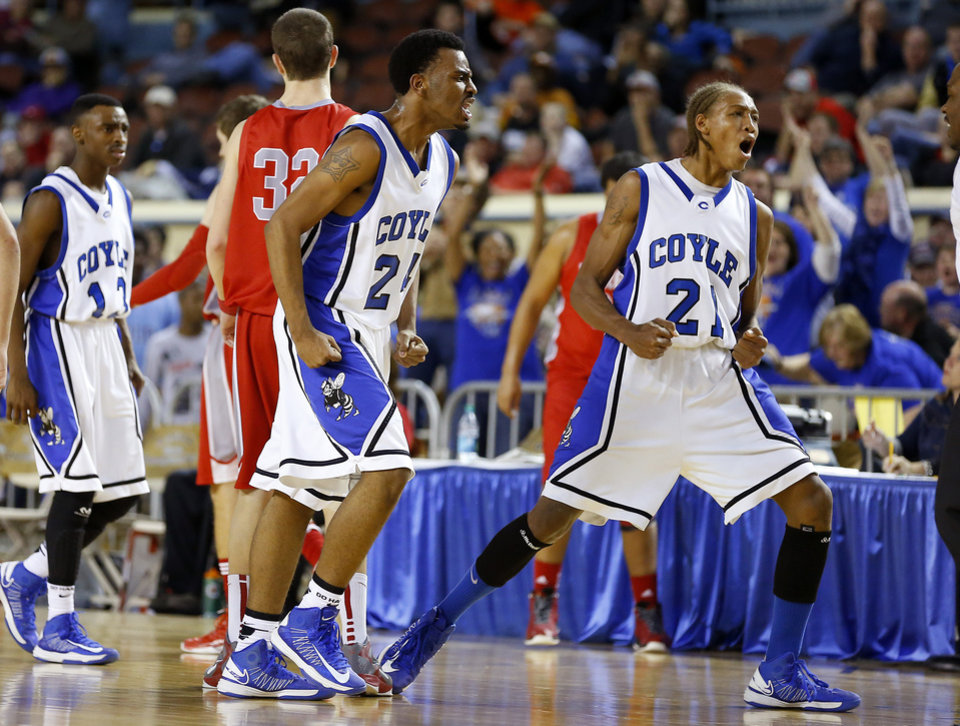 Coyle's Jakobi Brown, left, and Tony Aska celebrate during a Class B Boys game of the state high school basketball tournament between Forgan and Coyle at the State Fair Arena at State Fair Park in Oklahoma City, Thursday, Feb. 28, 2013. Photo by Bryan Terry, The Oklahoman