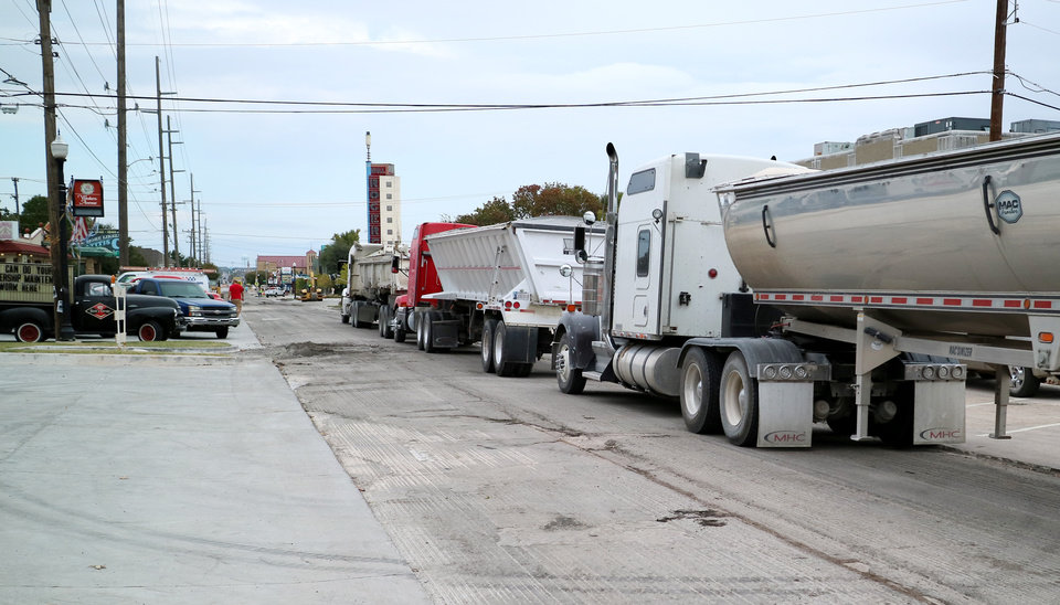 Photo -  Road resurfacing on Western between NW 41 and NW 46 streets is making it hard to get to local businesses on Wednesday. [Photo by Doug Hoke, The Oklahoman]
