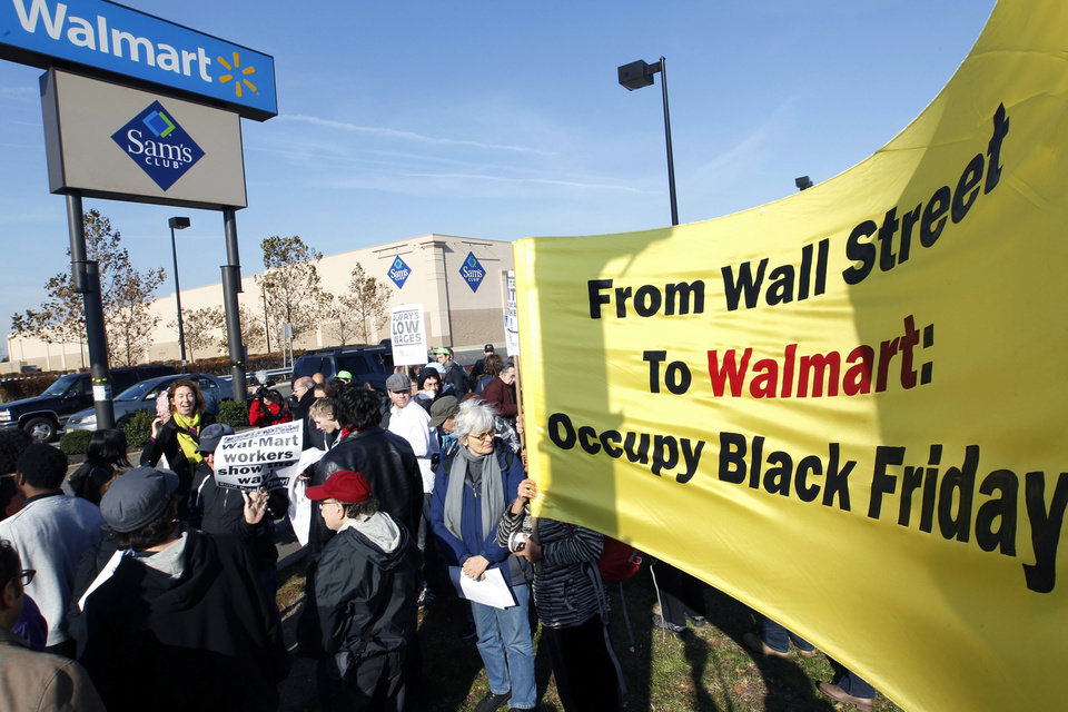 "Occupy Wall Street's ""99 Picket Lines"" working group, joins a protest against Wal-Mart on Black Friday, Nov 23, 2012, in Secaucus, N.J. Wal-Mart employees and union supporters are taking part in today's nationwide demonstration for better pay and benefits A union-backed group called OUR Walmart, which includes former and current workers, was staging the demonstrations and walkouts at hundreds of stores on Black Friday, the day when retailers traditionally turn a profit for the year. (AP Photo/Mel Evans)"