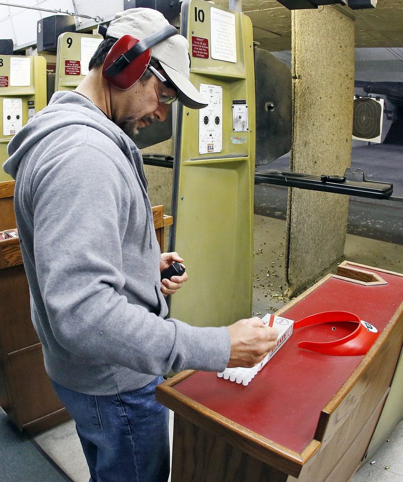 Dr. John Belardo loads a magazine for his handgun during a concealed-carry class Wednesday at H&H Gun Range and Shooting Sports Complex in Oklahoma City. Photo by Nate Billings, The Oklahoman <strong>NATE BILLINGS</strong>