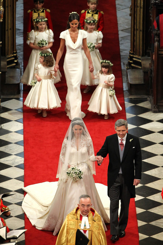 Photo - Bride Kate Middleton walks down the isle with father Michael at Westminster Abbey, central London, for her  wedding to Britain's Prince William,  Friday April 29, 2011.  (AP Photo/Andrew Milligan/Pool)  ORG XMIT: RWAJP115