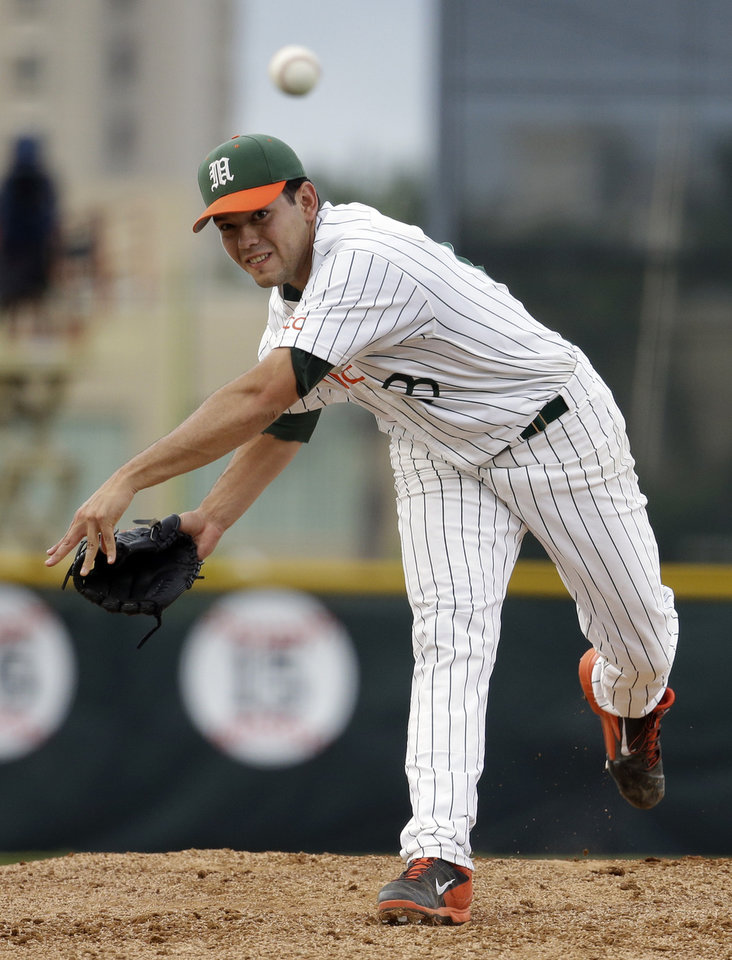 Photo - Miami pitcher Chris Diaz throws in the first inning against Texas Tech during an NCAA college baseball regional tournament in Coral Gables, Fla., Saturday, May 31, 2014. (AP Photo/Lynne Sladky)