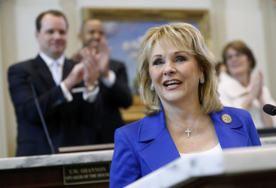 Oklahoma Gov. Mary Fallin is applauded as she begins her annual State of the State address to lawmakers as the 2013 legislative session gets underway in Oklahoma City, Monday, Feb. 4, 2013. (AP Photo/Sue Ogrocki) ORG XMIT: OKSO101
