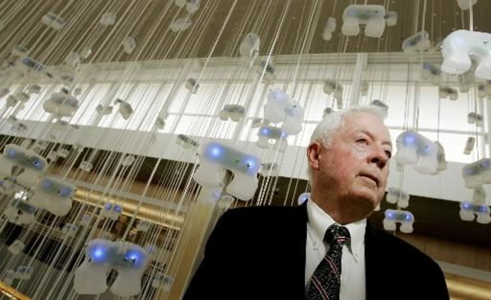 Photo - 2008 file photo - Paul  Risser, former chancellor who now heads OU's research cabinet. Photographed surrounded by the electronic artwork Bion at the Stephenson Research and Technology Center in Norman,. Wed. March 5, 2008. BY JACONNA AGUIRRE