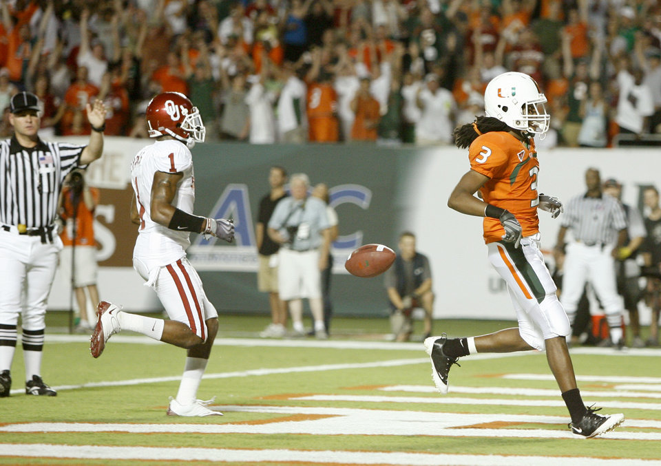 Photo - Miami's Travis Benjamin scores a touchdown in front of OU's Dominique Franks during the college football game between the University of Oklahoma (OU) Sooners and the University of Miami (UM) Hurricanes at Land Shark Stadium in Miami Gardens, Florida, Saturday, October 3, 2009. Photo by Bryan Terry, The Oklahoman