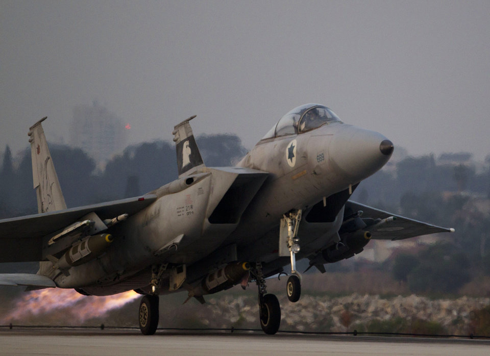 Photo -   An Israeli air force jet fighter plane takes off from Tel Nof air force base for a mission over Gaza Strip in central Israel, Monday, Nov. 19, 2012. (AP Photo/Ariel Schalit)