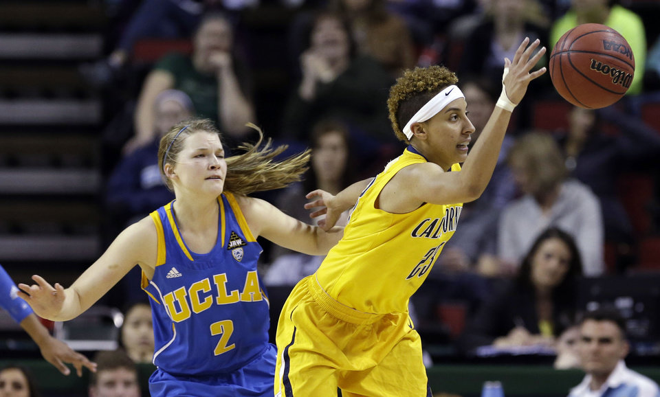 Photo - UCLA's Kari Korver (2) defends as California's  Layshia Clarendon tries to control the ball in the first half of an NCAA college basketball game in the Pac-12 Conference tournament Saturday, March 9, 2013, in Seattle. (AP Photo/Elaine Thompson)