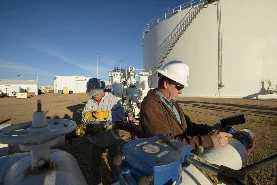 Photo - SemGroup Corp. employees conduct meter proving in Plattville, Colo. Tulsa-based SemGroup in 2011 spun off many of its pipelines and other midstream assets as Rose Rock Midstream LP,  as a way to attract new investors and raise money.   David X. Tejada