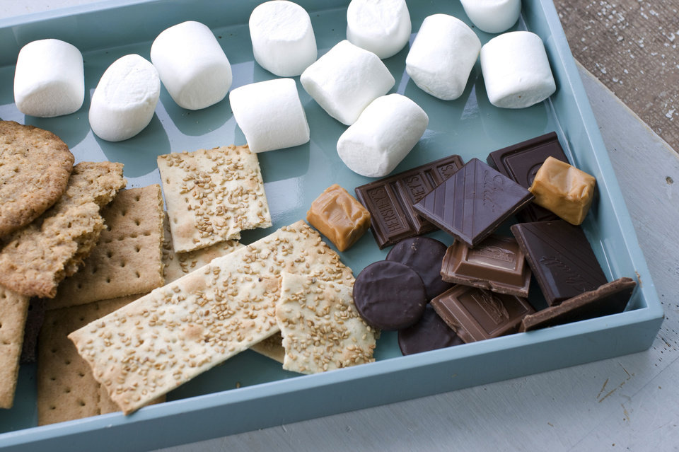 Photo - Ingredients for making toasted mocha s'mores, salted oatmeal s'mores, sesame caramel s'mores, and double chocolate grasshopper s'mores are gathered on a tray. AP Photo  Matthew Mead - AP