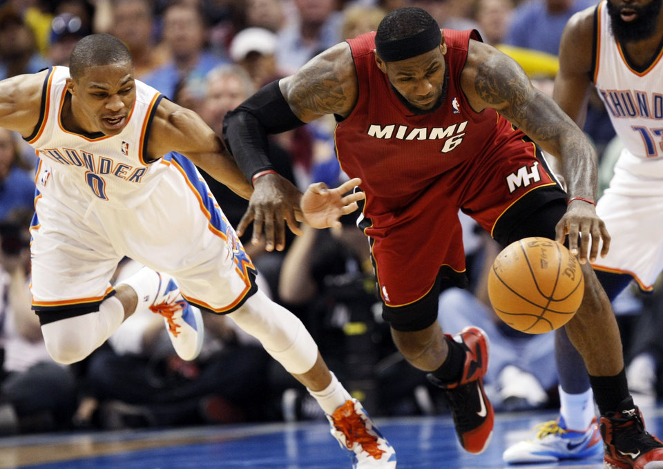 Miami\'s LeBron James (6) and Oklahoma City\'s Russell Westbrook (0) chase a loose ball during the NBA basketball game between the Miami Heat and the Oklahoma City Thunder at Chesapeake Energy Arena in Oklahoma City, Sunday, March 25, 2012. Oklahoma City won, 103-87. Photo by Nate Billings, The Oklahoman