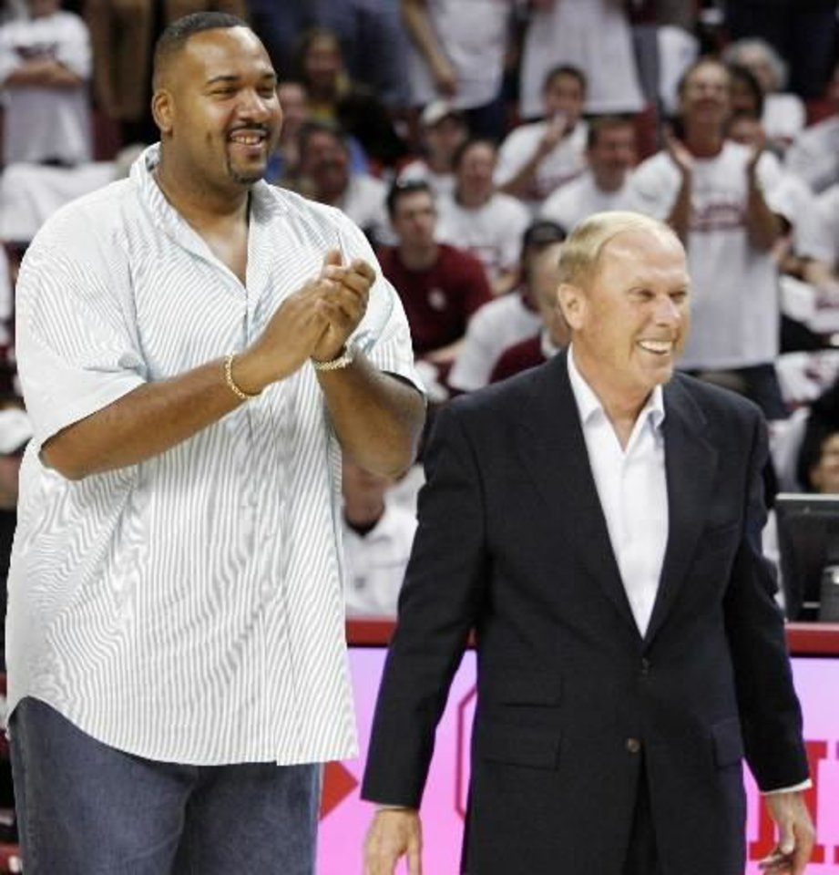 Photo - Former OU player  Stacey  King, left, and former OU basketball coach Billy Tubbs smile during a tribute to the 1988 OU men's basketball team at halftime of the men's college basketball game between University of Oklahoma and Texas A&M University at the Lloyd Noble Center in Norman, Okla., Saturday, March 1, 2008. BY NATE BILLINGS, THE OKLAHOMAN