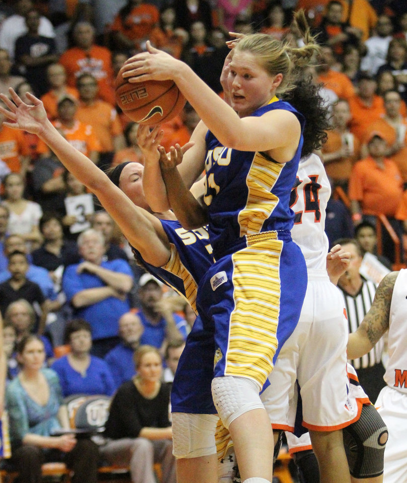 Photo - Clarissa Ober, center, of South Dakota State pulls down a rebound against UTEP during their WNIT semi final game Wednesday, April 2, 2014 in the Don Haskins Center in El Paso, Texas. (AP Photo/The El Paso Times, Rudy Gutierrez)  EL PASO OUT   JUAREZ, MEXICO, OUT