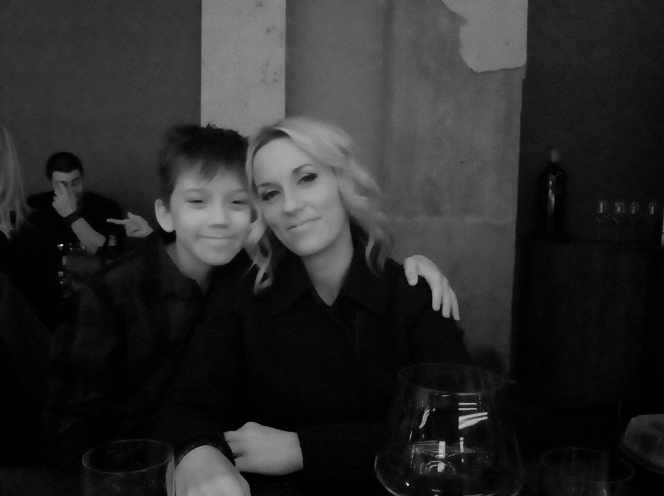 Photo - After her makeover, Christa Gray poses with her son, Tristan Duggan, at Red PrimeSteak. Photo provided.