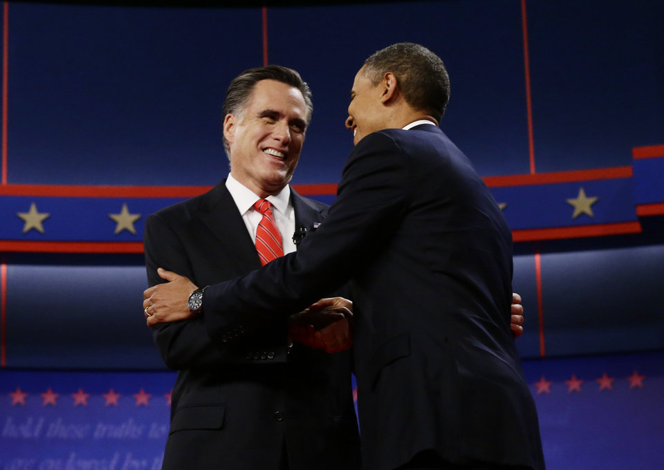 Photo -   President Barack Obama and Republican presidential candidate and former Massachusetts Gov. Mitt Romney meet on stage at the start of the first presidential debate in Denver, Wednesday, Oct. 3, 2012. (AP Photo/Charles Dharapak)