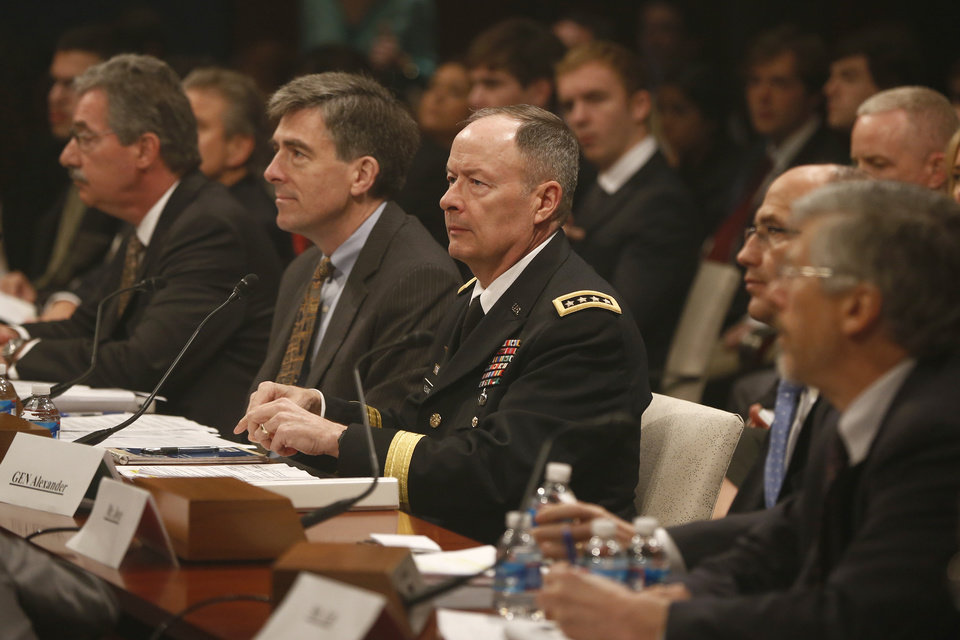 Photo - From left, Deputy Attorney General James Cole; National Security Agency (NSA) Deputy Director Chris Inglis; NSA Director Gen. Keith B. Alexander; Deputy FBI Director Sean Joyce; and Robert Litt, general counsel to the Office of the Director of National Intelligence; prepares to testify on Capitol Hill in Washington, Tuesday, June 18, 2013, before the House Intelligence Committee hearing regarding NSA surveillance. (AP Photo/Charles Dharapak)