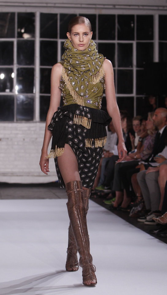 Photo -   The Altuzarra Spring 2013 collection is modeled during Fashion Week, Saturday, Sept. 8, 2012, in New York. (AP Photo/Jason DeCrow)