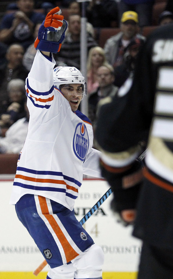 Photo - Edmonton Oilers right wing Nail Yakupov, of Russia, celebrates scoring a goal against the Anaheim Ducks during the first period of an NHL hockey game, Friday, Jan. 3, 2014, in Los Angeles. (AP Photo/Alex Gallardo)