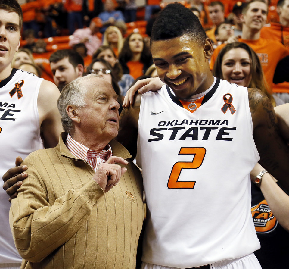 Photo - Boone Pickens talks to Oklahoma State's Le'Bryan Nash (2) during the singing of the alma mater after a men's college basketball game between Oklahoma State University (OSU) and the University of Texas at Gallagher-Iba Arena in Stillwater, Okla., Saturday, March 2, 2013. OSU won, 78-65. Photo by Nate Billings, The Oklahoman