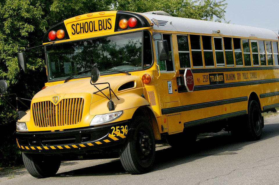 An Oklahoma City school bus leaves the district's transportation center in northeast Oklahoma City, Thursday,  Aug. 7, 2008.   BY JIM BECKEL, THE OKLAHOMAN