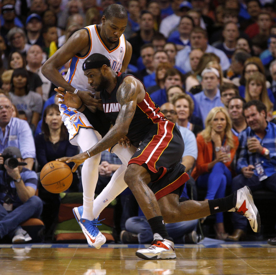 Miami\'s LeBron James (6) goes past Oklahoma City\'s Kevin Durant (35) during an NBA basketball game between the Oklahoma City Thunder and the Miami Heat at Chesapeake Energy Arena in Oklahoma City, Thursday, Feb. 20, 2014. Photo by Bryan Terry, The Oklahoman