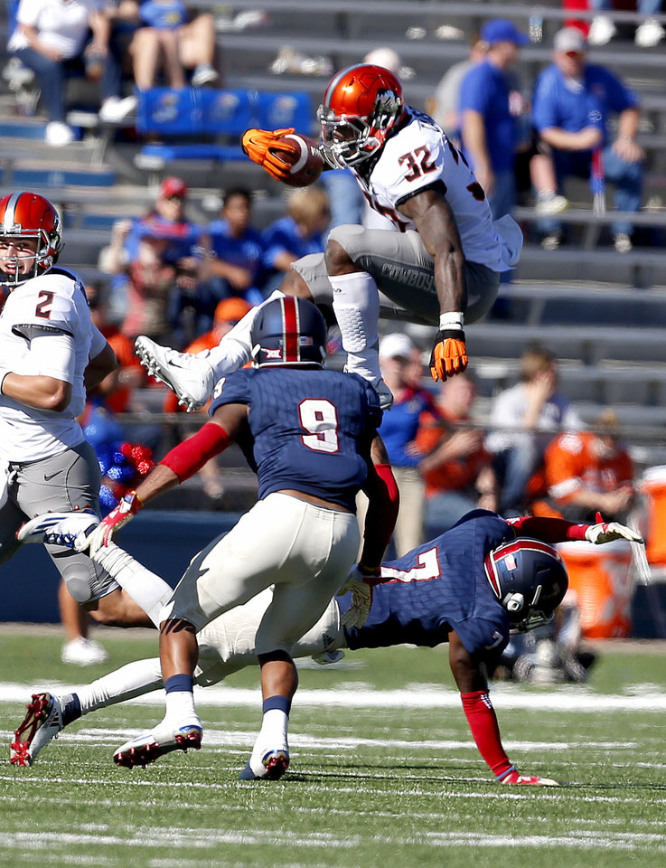 Osu running backs lead the way in 44 20 victory against kansas for Kansas fish and game