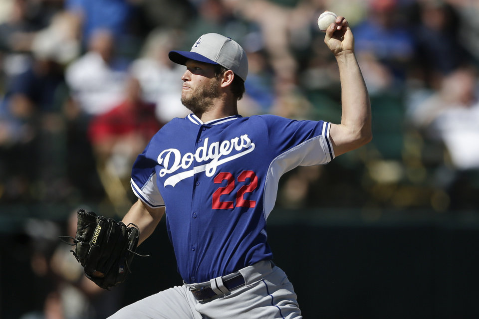 Photo - Los Angeles Dodgers pitcher Clayton Kershaw pitches to an Oakland Athletics batter during the first inning of a spring training baseball game Monday, March 3, 2014, in Phoenix. (AP Photo/Gregory Bull)
