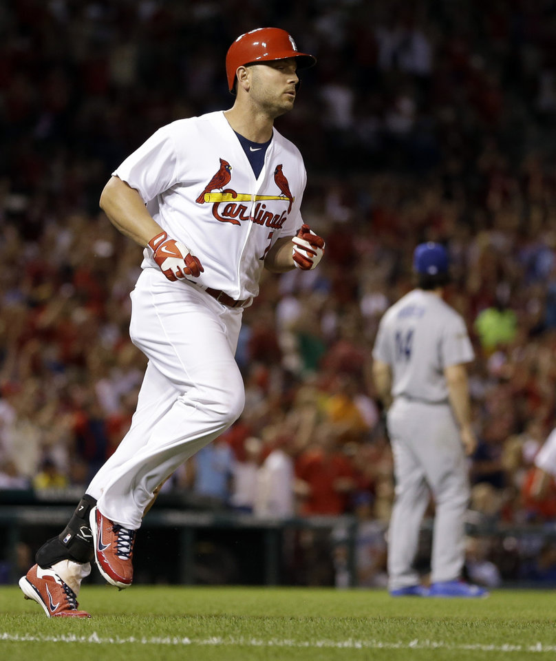 Photo - St. Louis Cardinals' Matt Holliday rounds the bases after hitting a two-run home run off Los Angeles Dodgers starting pitcher Dan Haren during the fifth inning of a baseball game Friday, July 18, 2014, in St. Louis. (AP Photo/Jeff Roberson)