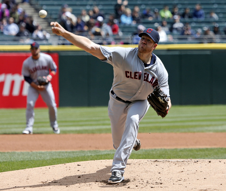 Photo - Cleveland Indians starting pitcher Zach McAllister delivers during the first inning of a baseball game against the Chicago White Sox, Wednesday, April 24, 2013, in Chicago. (AP Photo/Charles Rex Arbogast)