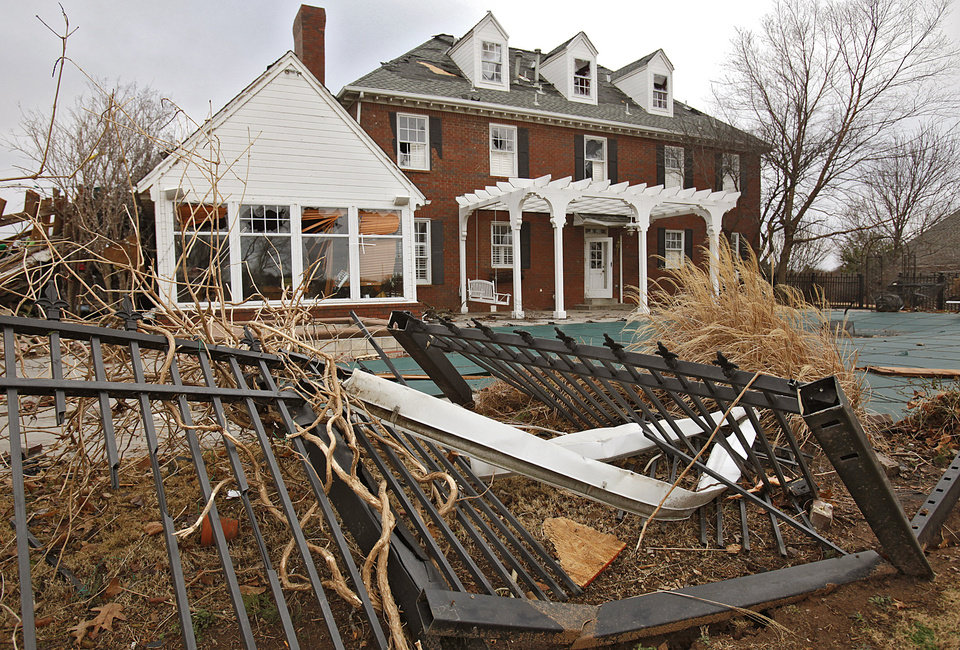 Damage to a home in the Oak Tree addition on Wednesday, Feb. 11, 2009, after a tornado hit the area on Tuesday in Edmond, Okla. PHOTO BY CHRIS LANDSBERGER, THE OKLAHOMAN
