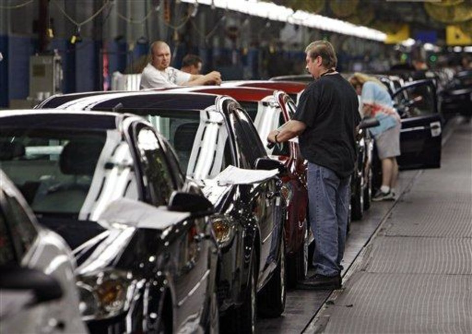 Workers at General Motors\' Lordstown Assembly plant in Lordstown, Ohio put the final touches on Chevy Cobalts Tuesday, June 15, 2010. (AP Photo/Mark Duncan)