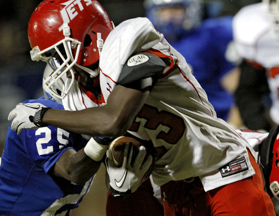 Photo - Western Heights' Devontae Henderson tries to get past Guthrie's J.T. McFadden during their high school football game in Guthrie on Friday, Oct. 28, 2011. Photo by John Clanton, The Oklahoman
